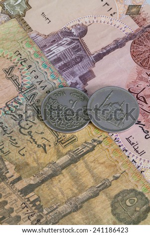 Different Egyptian coins and banknotes on the table - stock photo