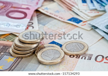 Different euro banknotes and coins special funds - stock photo