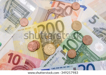 Different Euro banknotes with coins - stock photo