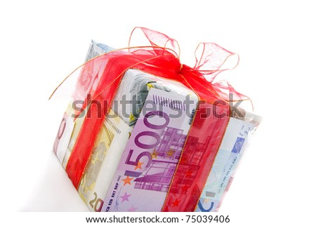 Different euro bills with red ribbon packed as a gift box isolated on a white background - stock photo