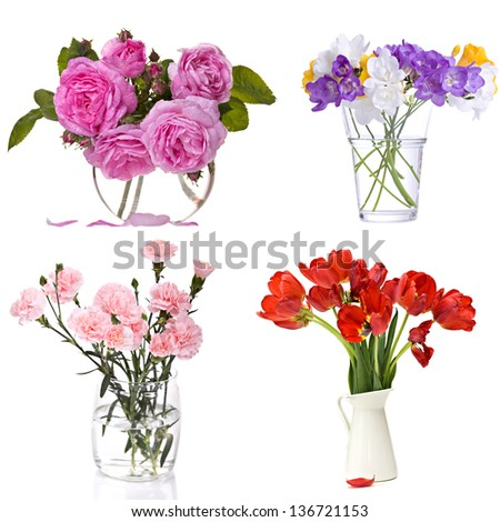 Different flowers in vase isolated over white - stock photo