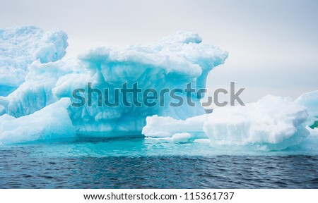 Different forms of iceberg in Antarctic waters - stock photo