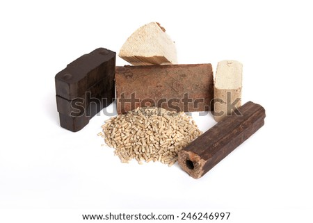 different fossil fuels on white background, carbon, oven wood, pellets, briquettes,  - stock photo