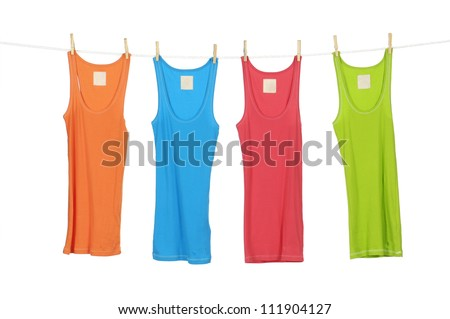 different four colorfulvshirt clothespins on rope - stock photo
