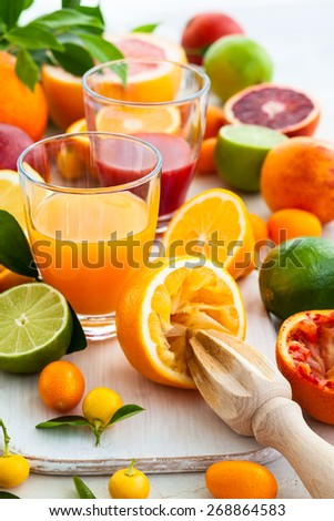 Different fresh citrus juices - stock photo
