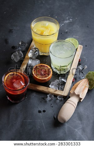 Different fresh cocktail on dark background, selective focus - stock photo