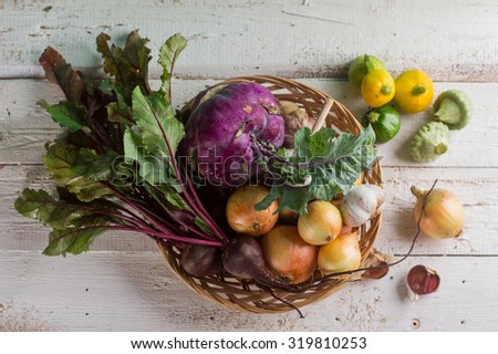 Different fresh vegetables in wooden basket, selective focus - stock photo