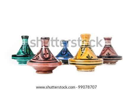 Different handmade ceramic Tajines isolated on a white background - stock photo
