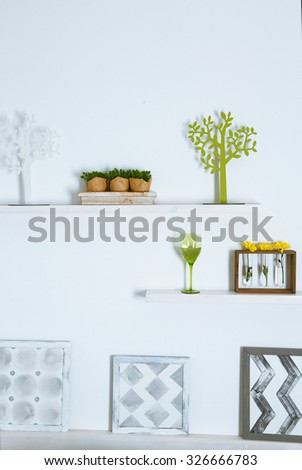 Different home objects and decoration on shelves on white wall background - stock photo