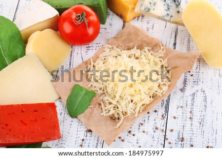 Different Italian cheese on wooden background - stock photo