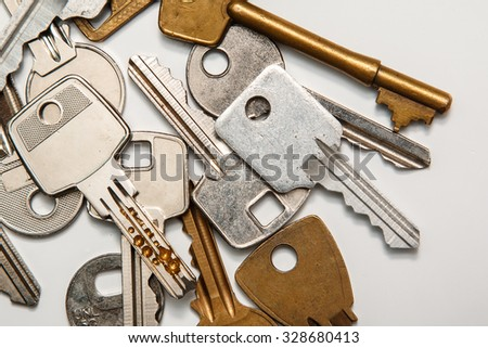 Different keys on white surface - stock photo
