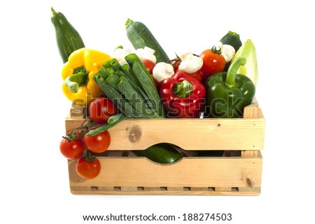Different kind of vegetable in a wooden crate - stock photo