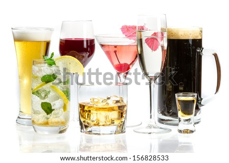 Different kinds of alcohol on a white background - stock photo