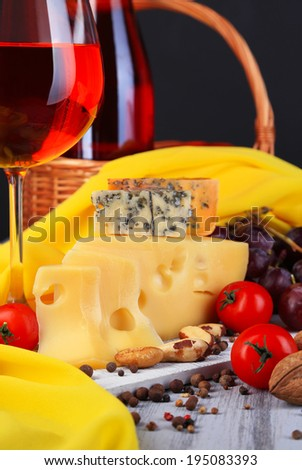 Different kinds of cheese with wine on table close-up - stock photo