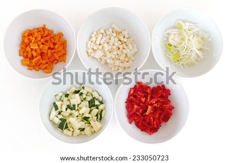 different kinds of chopped vegetables in white bowls, cooking preparation - stock photo