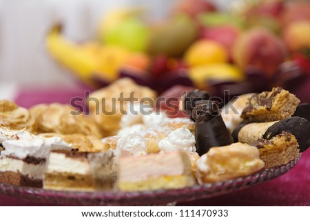 different kinds of desserts on a plate - stock photo