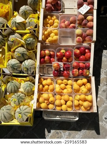 different kinds of fruit on a marketplace counter - stock photo