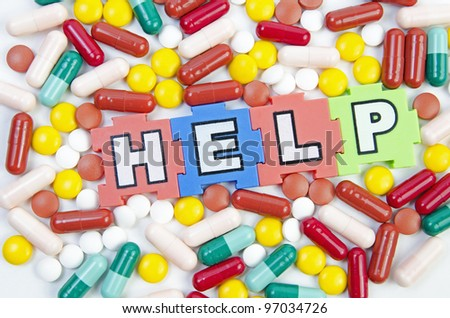 different kinds of medicinal pills in different colors - stock photo