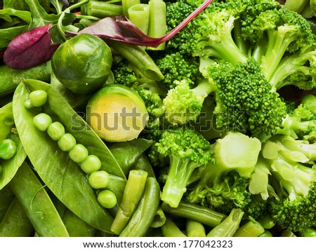 Different kinds of vegetables on the wooden background. Shallow dof.  - stock photo