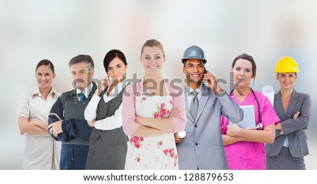 Different kinds of workers on grey blurred background - stock photo
