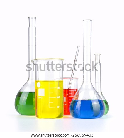 Different laboratory glassware with colored liquid isolated over white background. - stock photo