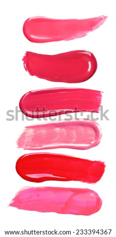 Different lip glosses isolated on white - stock photo