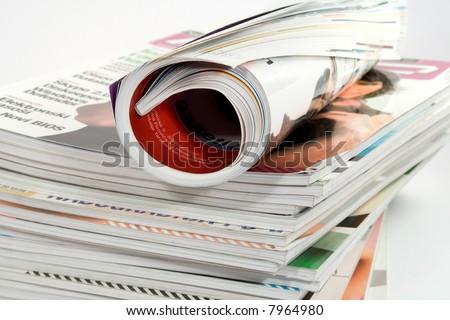 different magazines studio isolated on white - stock photo