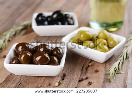 Different marinated olives on table close-up - stock photo