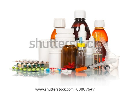 Different medical bottles and tablets isolated on white - stock photo
