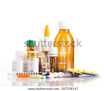 Different medicament in bottles, ampules and tablets with insulin syringe  on white background - stock photo