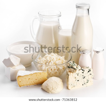 Different milk products: cheese cream, milk, yoghurt. On a white background. - stock photo