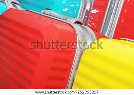 different modern suitcases in the shop - stock photo