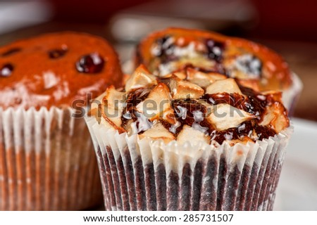 different muffins with fresh apples on white - stock photo