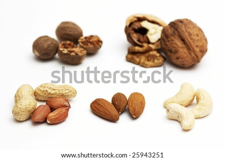 Different nuts isolated on a white - stock photo