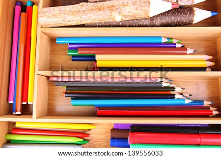 Different pencils in wooden crate, close up - stock photo