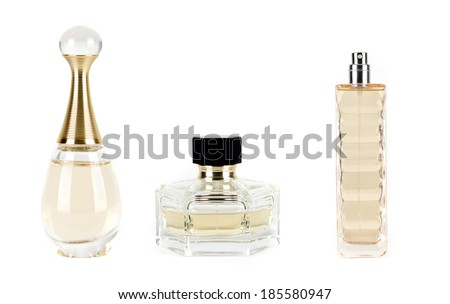 different perfumes on a white background - stock photo