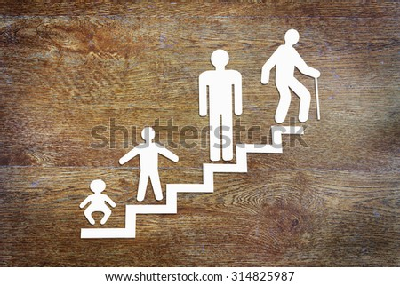 Different phases of human development. Abstract conceptual image. with scrapbooking on wooden backgroundjpg - stock photo
