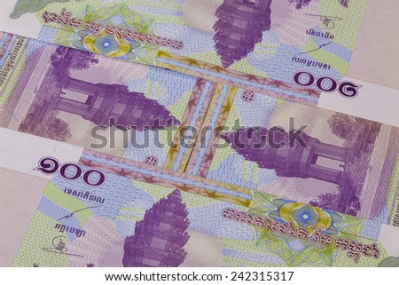 Different Riel banknotes from Cambodia on the table - stock photo