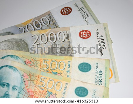 Different Serbian dinar bills scattered on white background. - stock photo