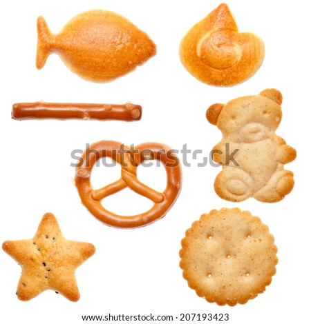 Different shaped crackers and pretzels on white background - stock photo