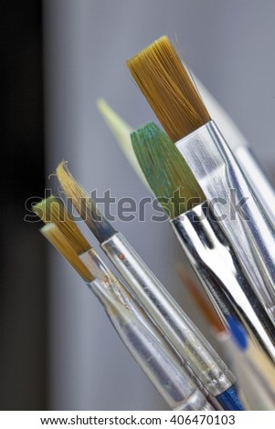 Different size of artist used paints brushes - stock photo