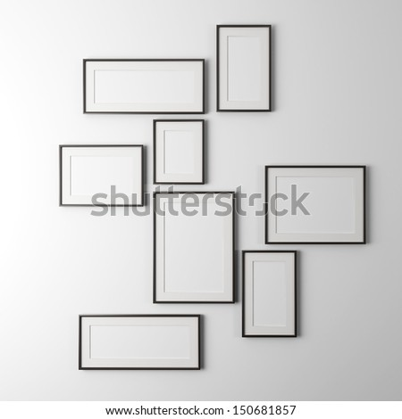 different sized empty photo frames - stock photo