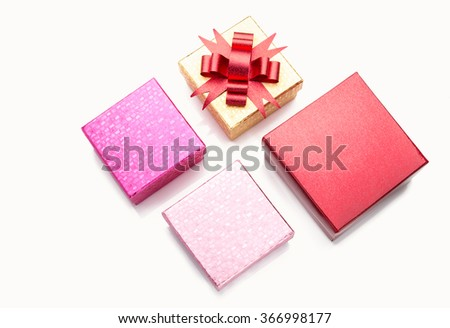 Different sizes color gift boxes on white background with some reflection and shadow - stock photo