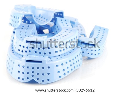 different sizes of acrylic trays for teeth impressions - stock photo