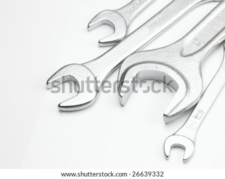 Different sizes of metal wrench in white background - stock photo