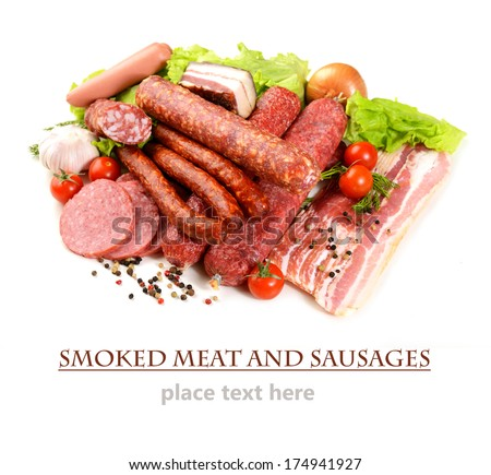 different smoked meat and sausage on a white background  - stock photo
