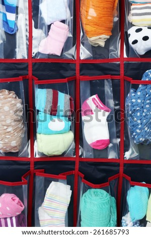 Different socks in hanging bag, closeup view - stock photo
