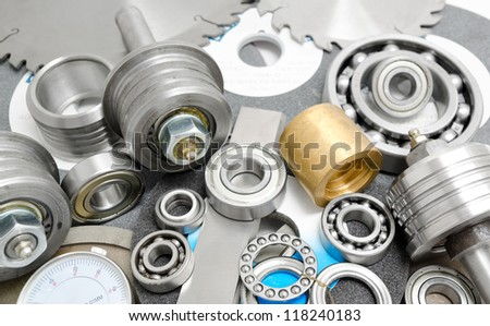 different spare parts for powersaw benches - bearings, saw blades, abrasive disks, bushes - stock photo