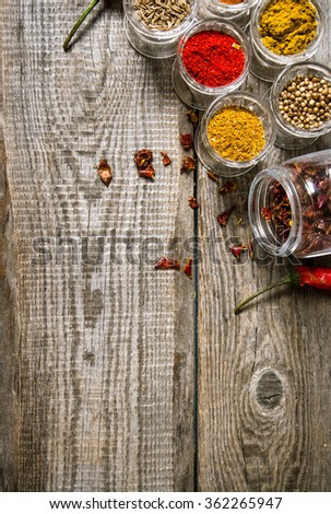 Different spices in glasses. On a wooden table.  Free space for text . Top view - stock photo