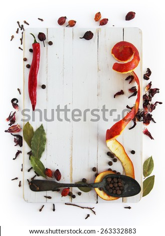 Different spices on a white wooden board - stock photo